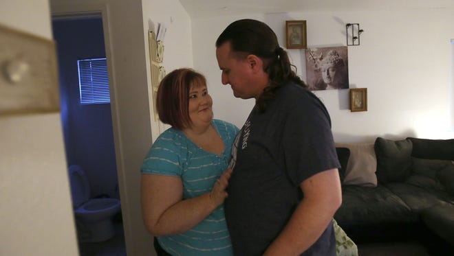 Kristy Beard and fiance Adam Berry embrace as they cross paths in their Joshua Tree apartment, Wednesday, May 13, 2015. Beard suffers from panic attacks and has been unable to locate clinical help.