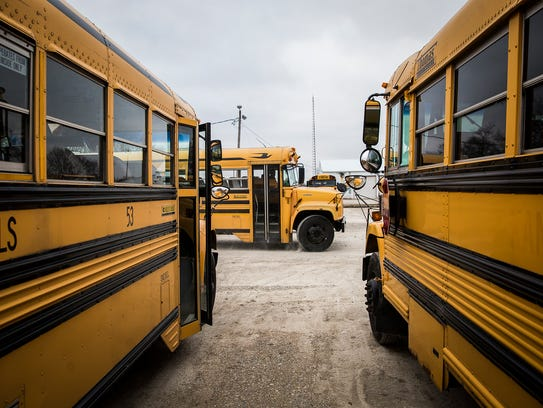 Drivers park their buses at M&M Bus Co. after school