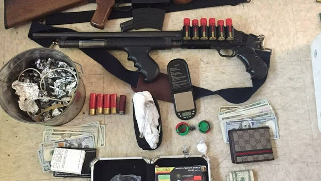 This photo shows the weapons and drugs found at a Salinas home on Oct. 26 where a special-needs child was living, authorities say.