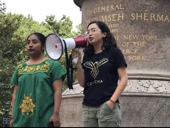 Thais Marques of Newark spoke at a protest in New York