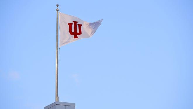 IU flag flying above Memorial Stadium in Bloomington.