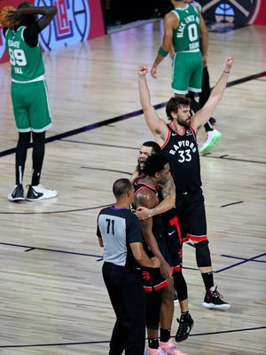 Toronto guard Fred VanVleet (23) hugs teammate OG Anunoby after Anunoby's buzzer-beater defeated the Celtics in Game 3 of their second round playoff series at ESPN Wide World of Sports Complex.
