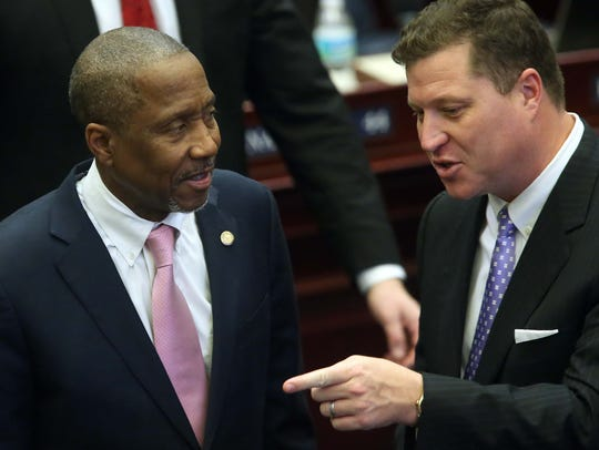 Rep. Darryl Rouson, D- St. Petersburg, (left) confers