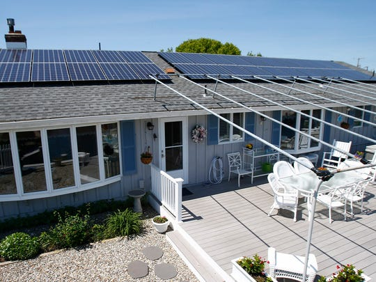 The solar panels are shown on Karen Coon's roof  at