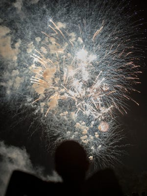 Martin Mendoza sits back and enjoys the fireworks on Wednesday night, July 4, 2018, at City Park in Fort Collins, Colo.