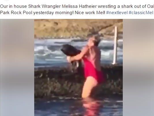 Woman tosses shark into ocean