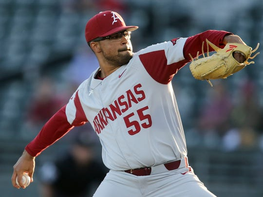 FILE - In this March 22, 2019, file photo, Arkansas pitcher Isaiah Campbell (55) delivers against Alabama during an NCAA college baseball game in Tuscaloosa, Ala. Isaiah Campbell looked hard at the financial package he was offered last spring as a mid-round draft pick of the Los Angeles Angels. The immediate impulse was to sign and begin his professional baseball career. Instead, Campbell chose to return to Arkansas for his junior season. It was a risky business decision, but for Campbell there was unfinished business. (Gary Cosby Jr./The Tuscaloosa News via AP, File)
