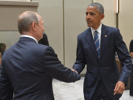 Russian President Vladimir Putin, left, shakes hands with U.S. President Barack Obama in Hangzhou in eastern China's Zhejiang province, Monday, Sept. 5, 2016.