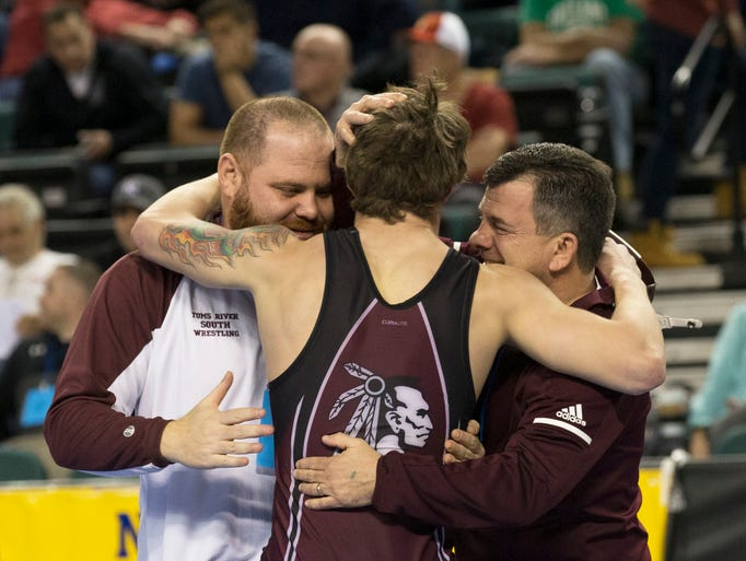 Corrigan celebrates with his coaches. Toms River South's