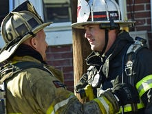 A firefighter exits a home at 29 South Franklin Street, Chambersburg, during a fire at the home Friday, Nov. 13, 2015. No injuries were reported at the fire that started in an upstairs bedroom.