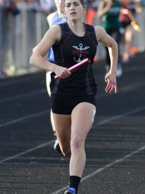 Manitowoc's Shelby Nickels runs the 4 x 200 relay Thursday May 25, 2017 at the West Bend sectionals at West High School in West Bend, Wis.