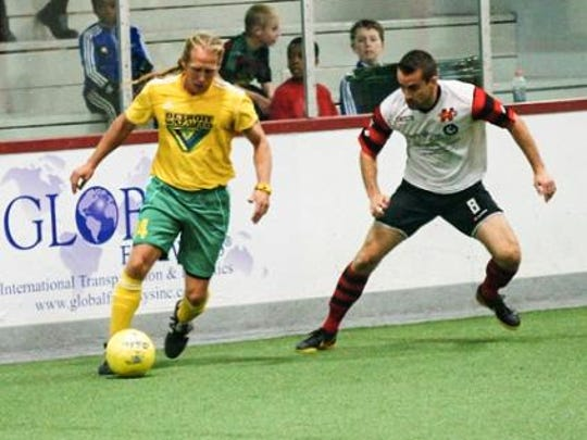 Dominic Scicluna, 46, Waza Flo co-owner, takes on a defender.