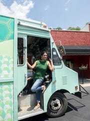 Suzy Phillips, owner of Gypsy Queen Cuisine, with her food truck.