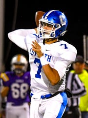 Cov Cath quarterback AJ Mayer throws a pass against