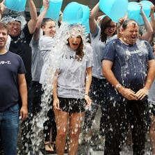 NEW YORK, NY - AUGUST 21:  (L-R) Ken Little, VP Engineering at Tumblr, Katherine Barna, Head of Communications at Tumblr, and Lee Brown, Head of Global Sales at Tumblr accept the ALS Ice Bucket Challenge during the ringing of the opening bell at the NASDAQ MarketSite on August 21, 2014 in New York City.