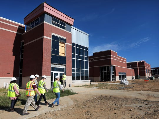 Principals and staff from the Collierville School District tour the new $94 million high school that is slated to open in August 2018. Construction continues on what will be one of the largest high schools in Tennessee with over 450,000 square feet the school will be built to easily accommodate 3,000 students.