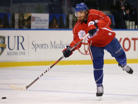 Rochester Amerks defenseman Zach Redmond rips a shot