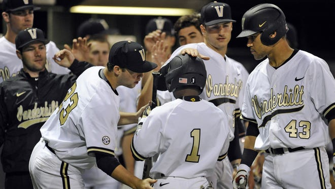George Walker IV / The Tennessean Vanderbilt has lost four of its past five games for its worst stretch since 2012. But coach Tim Corbin and players say they are not panicking heading to a series at South Carolina. Teammates congratulate Vanderbilt designated hitter Ro Coleman (1) after he scored during their game against  Belmont at Hawkins field Tuesday April 14, 2015, in Nashville, Tenn.
