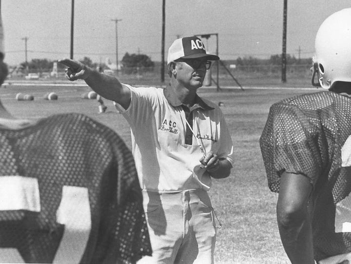 Wally Bullington directs his players during his time