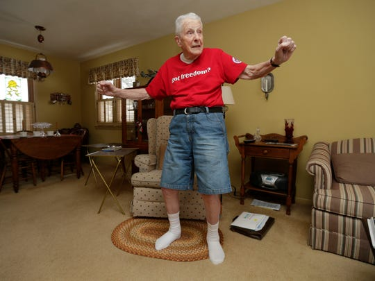 "Chuck Franzke dances to Frank Sinatra's version of  ""Jingle Bells"" in his Waukesha home."