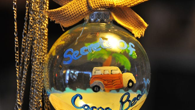 Karen Dooley started Secrets of Cocoa Beach as a positive Facebook page about Cocoa Beach. The Facebook page grew into a popular store and gallery of local and handmade goods in downtown Cocoa Beach. A handpainted Chrismas ornament.
