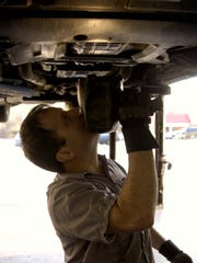 Direct Buy Auto Warranty will stop offering motor vehicle service contracts to New Jersey consumers and shut down its office within six months. An auto technician is seen in a 2004 file photo.