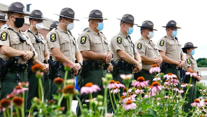 Illinois State Troopers stand together Sunday during the unveiling of the Brooke Jones-Story memorial plaque at the Winnebago County 911 Emergency Responders Memorial in Rockford.