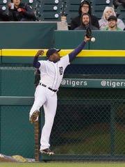 Detroit Tigers left fielder Justin Upton bobbles the ball hit by Oakland Athletics' Chris Coghlan before catching it during the third inning of a baseball game, Tuesday, April 26, 2016, in Detroit.