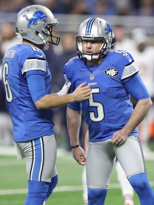 Lions kicker Matt Prater (5) is congratulated by holder Sam Martin after Prater kicked a field goal during the second quarter against the Bears at Ford Field on Dec. 11, 2016.