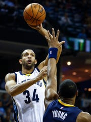 Memphis Grizzlies forward Brandan Wright (top) puts a shot over Indiana Pacer defender Thaddeus Young (bottom) during first quarter action at the FedExForum.