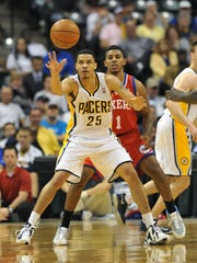 Indiana's Gerald Green reaches for a pass in front of Philadelphia's Nick Young late in the game as the Philadelphia 76ers defeated the Indiana Pacers 105-95 at Bankers Life Fieldhouse Wednesday April 17, 2013.