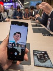 Attendees of Mobile World Congress 2018 are seen creating AR Emojis on the new Samsung Galaxy S9 on February 26, 2018 in Barcelona, Spain.
