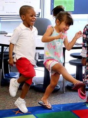EJ Jackson, left and Jada Mysayphonh, right dance as they introduce themselves during a game in Kinder Camp, on Wednesday, July 18, 2018 at the school. The camp is designed for kindergarten students to learn about school before starting. The camp ran from Monday through Friday from 9 AM-1 PM.