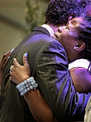 Tears flow down the cheeks of Shaundelle Brooks, mother of Waffle House mass shooting victim Akilah DaSilva, as the casket is closed at his funeral at the Olive Branch Church on Saturday May 5, 2018, in Nashville, Tenn.