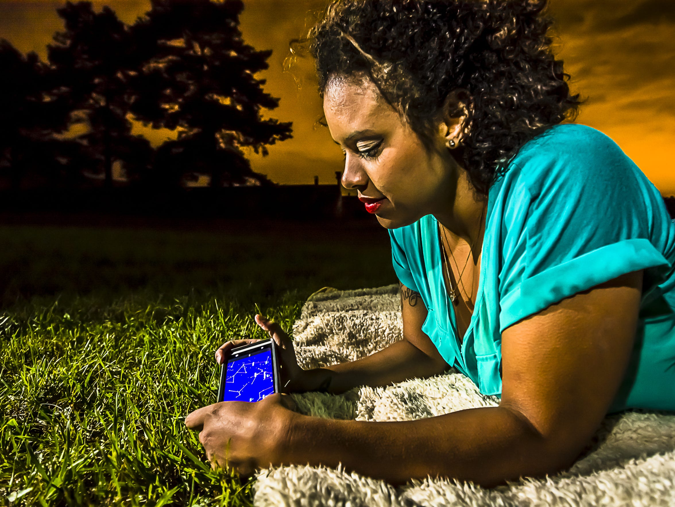Tashmica Torok uses her Google Sky app to aid in her