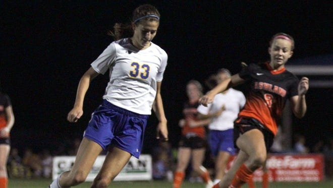 Ontario's Amanda Kuenzli keeps the ball away from Ashland's Megan Cornell during a match at the Warriors' field on Tuesday night.