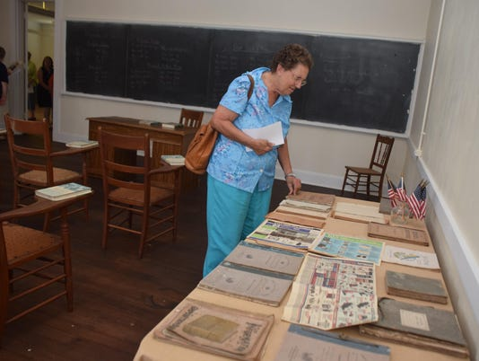 ANI Lecompte High School Museum Carol Ann Norsworthy Keller looks at items on display in one of the classrooms of Lecompte High School. The Rapides Parish Library Johnson Branch and the members of the Johnson Friends of the Library are collaborating with t