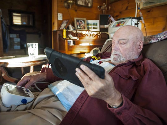 Con Hogan, a member of the Green Mountain Care Board, needs a kidney transplant.  He monitors his blood pressure as he is hooked up to a dialysis machine at home in Plainfield on Wednesday, November 18, 2015.