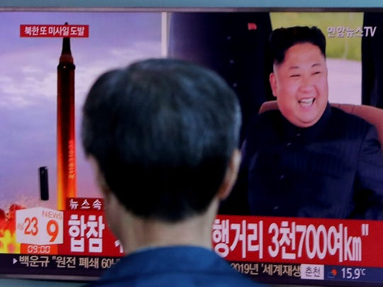 A man watches a TV screen showing a file footage of North Korea's missile launch and North Korean leader Kim Jong Un, at the Seoul Railway Station in Seoul, South Korea, in this Sept. 15, 2017, file photo.