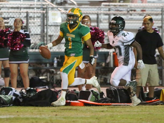 Coachella Valley quarterback Armando Deniz runs for