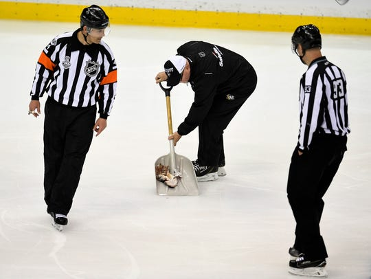 A Penguin worker scoops up the catfish during the second