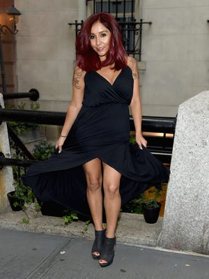 Nicole 'Snooki' Polizzi poses for a photo showing her new hair color in front of the Vidov Salon on July 2, 2015 in New York City.
