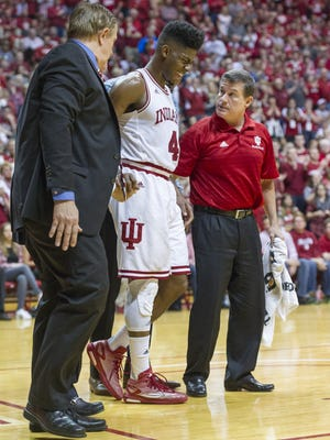 Indiana Hoosiers guard Robert Johnson (4) grimaces as he leaves the court after suffering an apparent injury to his left ankle during an NCAA men's college basketball game at Indiana University's Assembly Hall in Bloomington, Ind., Saturday, Feb. 20, 2016. IU won, 77-73.