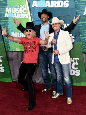 Big Kenny, from left, Cowboy Troy, and John Rich arrive at the CMT Music Awards at Bridgestone Arena in 2015.