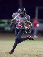 Keyshawn Helton (5) looks for open field during the