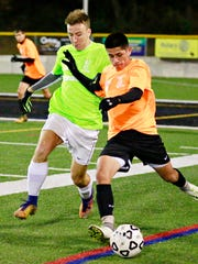 York Catholic's Tate Kibler, left, and Biglerville's Antonio Salazar compete for control of the ball during boys' All-Star soccer action on Horn Field at Red Lion Area High School in Red Lion, Wednesday, Nov. 15, 2017. Dawn J. Sagert photo