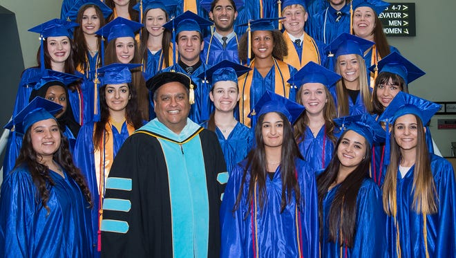 Group photo of Valley dual grads from Rio Salado Commencement Ceremony with President Chris Bustamante.