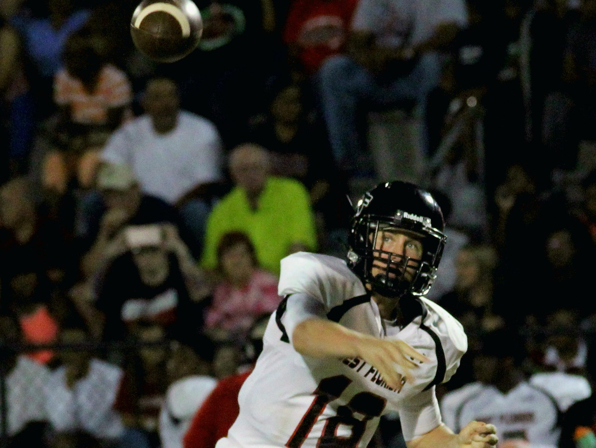 West Florida's Cody Smith launches a pass in the first quarter.