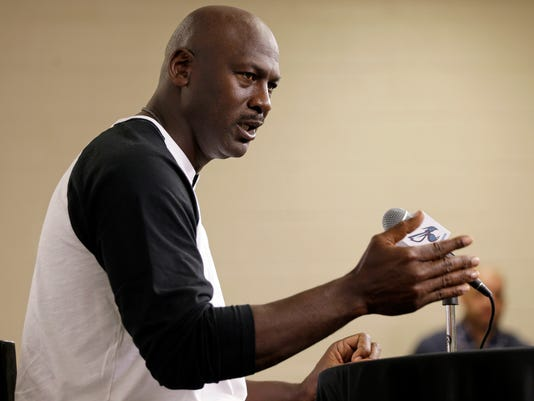 Charlotte Hornets owner Michael Jordan answers a question from the media during a news conference about the NBA basketball team in Charlotte, N.C., Tuesday, Oct. 28, 2014. (AP Photo/Chuck Burton)