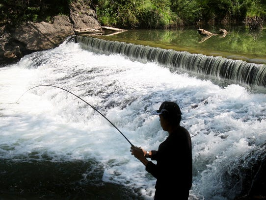 Dlfin Rizan fishes on the Harpeth River in Franklin